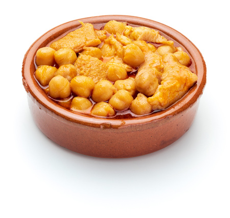 Chickpeas with tripe (callos) in clay pot. Isolated on white background. Stock Photo