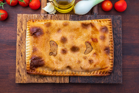 Tuna pie. Typical Galician dish (Galicia) and Spain. With natural ingredients such as tomato, onion, pepper, eggplant, tuna, boiled egg, wheat and vegetable oil. Fish and vegetables cake. Stock Photo