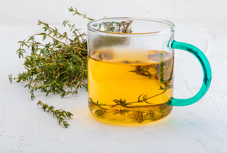 Infusion of thyme. Ingredient of Mediterranean cuisine and healing home remedy. Home remedy healing, disinfectant, relieves breathing problems, with anti-aging flavonoids, for indigestion, strengthens the immune system, lowers blood pressure,…