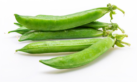 Green, tender, fresh and raw peas. Isolated on white background.