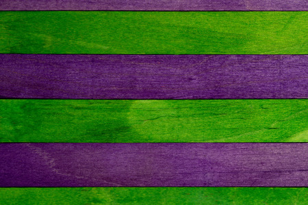Beautiful texture of natural wood slats of green and purple colors. Natural and aged appearance. Foto de archivo