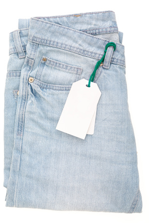 Light blue jeans with tag. Isolated on white background. Banco de Imagens