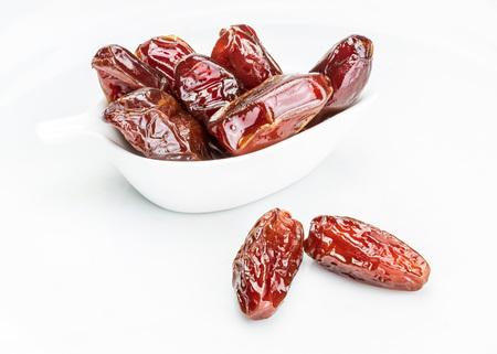 Close-up of juicy dates (fruit). Isolated on white background.