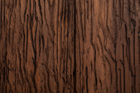 Precious wood texture. Of rustic aspect and dark, ocher, brown, toasted, black tones. The veins and knots are appreciated.