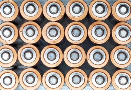 Texture AA electric batteries (AAA). Positive pole view (+ -)