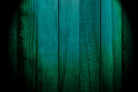 Beautiful texture of slats of natural wood of dark green color (turquoise). With light bulb. Vertical sense.