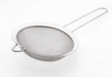 Metallic colander for cooking (kitchenware collection). Isolated on white background.
