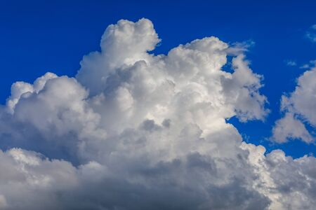 Clouds over blue sky. Sunny day and moment before the summer storm. 写真素材