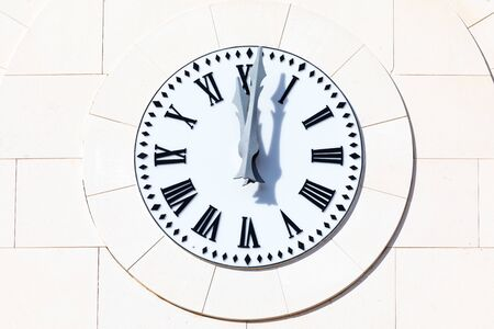 Clock shows 12 oclock and 1 minute (00:01 h, 12:01 h, 24:01 h, twelve hours and one minute). New Years Eve bells (New Years Eve at Christmas and New Year). Foreground, Close up.