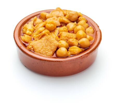Chickpeas with tripe (callos) in clay pot. Isolated on white background.