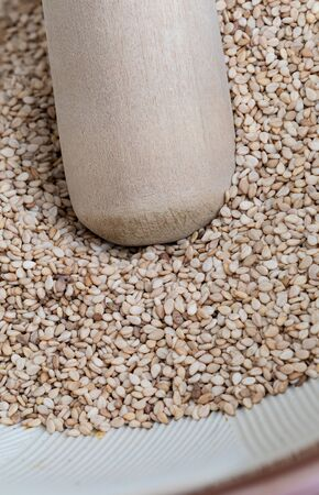 Close-up of sesame seeds in Suribachi (Japanese streak mortar).Top view. Фото со стока