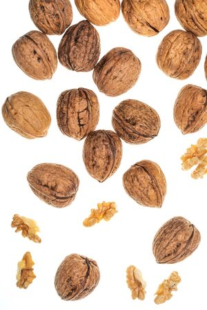 Nuts (whole and open) falling. Isolated on white background. Фото со стока