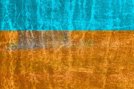 Cracked and old metallic texture. Silver colors in blue (cyan), ocher and oranges. Copy space.