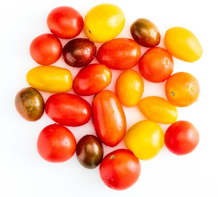 Colorful cherry tomatoes (red, garnet and yellow), fresh and raw. With water drops Isolated on white background. Фото со стока