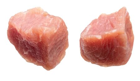 Raw and fresh (diced) pieces of turkey meat (chicken). Isolated on white background.