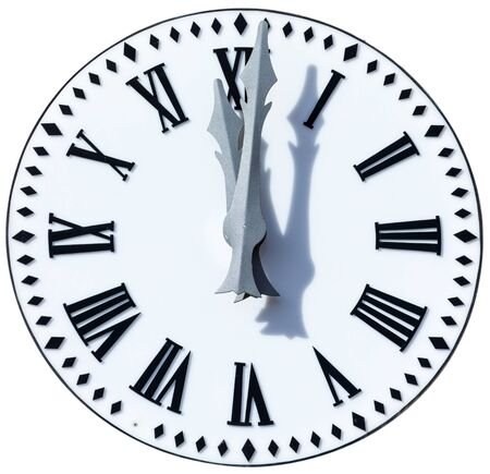 Clock shows 12 oclock and 1 minute (00:01 h, 12:01 h, 24:01 h, twelve hours and one minute). New Years Eve bells (New Years Eve at Christmas and New Year). Foreground, Close up. Isolated on white background