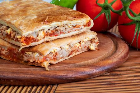 Tuna pie. Typical Galician dish (Galicia) and Spain. With natural ingredients such as tomato, onion, pepper, eggplant, tuna, boiled egg, wheat and vegetable oil.