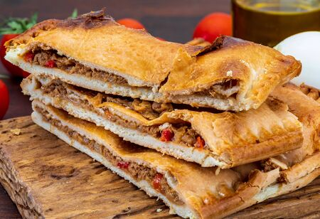 Tuna pie. Typical Galician dish (Galicia) and Spain. With natural ingredients such as tomato, onion, pepper, eggplant, tuna, boiled egg, wheat and vegetable oil. Fish and vegetables cake. Stok Fotoğraf