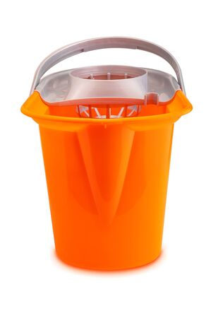 Bright orange mop bucket. Isolated on white background. Фото со стока - 134259898