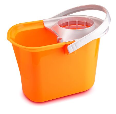 Bright orange mop bucket. Isolated on white background.