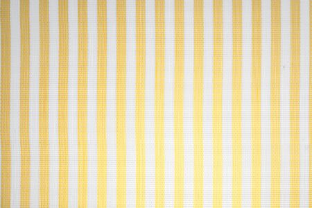 Tablecloth fabric with yellow and white lines (degraded light bulb). Home fabric.