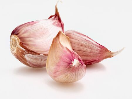 Set of red garlic cloves. Isolated on white background