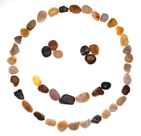 Emoji (emoticon) of smiling face made by hand with stones (boulders). Isolated on white background. Collection made with stones.