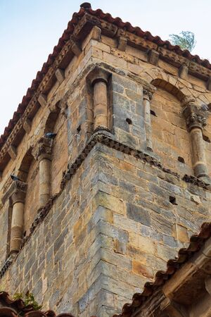 Close-up tower of the Collegiate Church of Santillana del Mar (Cantabria - Spain). Medieval village. Romanesque art of the twelfth century. Santiagos road
