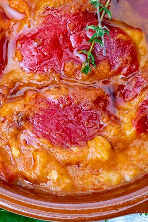 Peppers (del Piquillo) stuffed with meat or fish. Roasted red peppers and fillings made at home. Recipe of Spanish food and Mediterranean diet. With delicious sauce to spread bread. Фото со стока