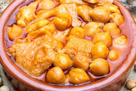 Chickpeas with tripe in clay pot. Aerial view. Foreground.