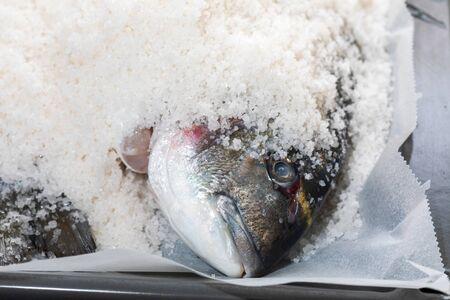 Gilthead breams cooked in salt. Baked fish (doradas).