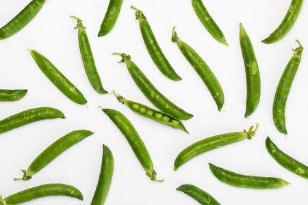 Green, tender, fresh and raw peas. Peas texture isolated on white background.