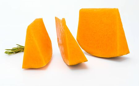 Pieces of fresh pumpkin isolated on white background. Close-up.