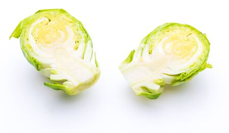 Close-up of raw, fresh brussels sprouts, cut in two halves (cabbages - Brassica oleracea). Isolated on white background. 版權商用圖片