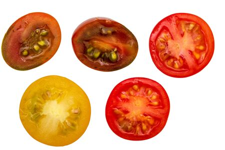 Fresh and raw cherry tomatoes (red, maroon and yellow), cut in half. With water drops Isolated on white background 版權商用圖片