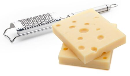Two portions (blocks) of Emmental Swiss cheese with a grater. Texture of holes and alveoli. Isolated on white background.