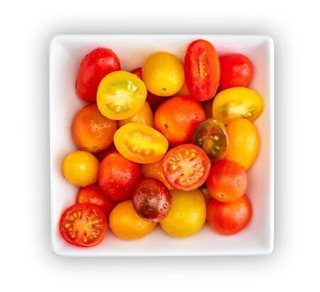 Bowl of colorful cherry tomatoes (red, garnet and yellow), fresh and raw. Cut and whole. Cenital plane (top view). With water drops, Isolated on white background.