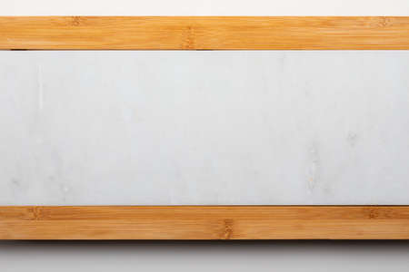 Empty table for cheeses and other openings. Copyspace (Copy space). White marble and wood. Top View.