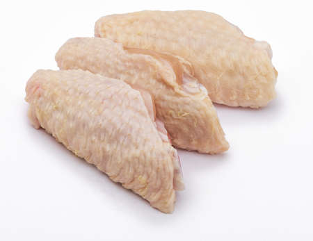 Three clean raw chicken wings, isolated on white background. Фото со стока
