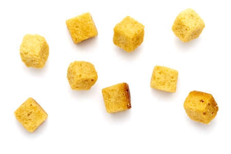 Cluster crispy croutons. Cubes of bread toasted and fried in oil. Isolated white background Фото со стока
