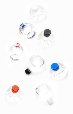 Background of transparent spherical water bottles with colored caps.