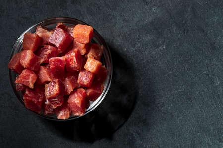 Iberian ham (serrano) cut into cubes in a glass bowl.