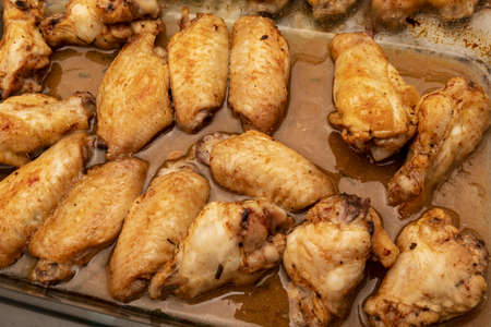 Home roasted chicken wings with honey sauce on a baking tray. Reklamní fotografie