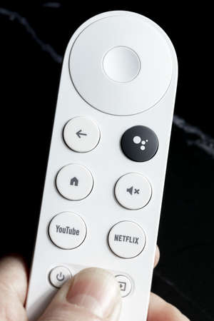 SPAIN - March 3, 2021. Close-up of the remote control for Chromecast with Google TV in one hand
