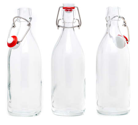 Several glass bottles with 500 ml soda type closures. Without label and isolated on white background.