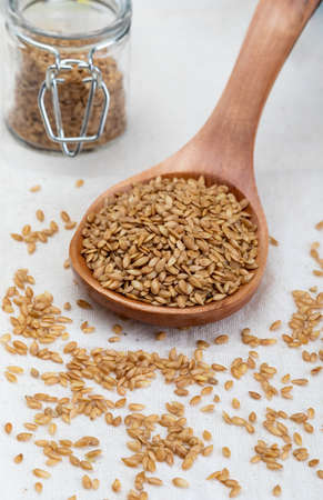 Golden flax seeds. Micronutrient beneficial for the organism that prevents and cures ailments. Rich in fiber and nutrients (manganese, vitamin B1, and above all, in omega-3 fatty acids) beneficial for healt (skin, weight loss, cholesterol reduction, celiac, antioxidants, ...) Stock fotó