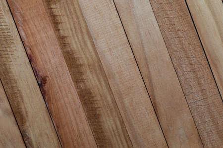 Texture of natural wood slats (unvarnished). Copper, reddish, cherry. Diagonal sense