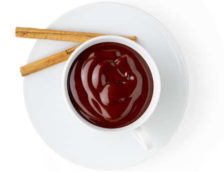 Cup of delicious thick drinkable hot chocolate with cinnamon stick. Bowl isolated on white background and copy space.