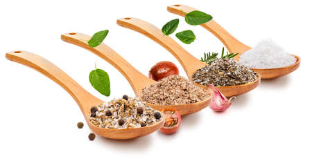 Variety of salt (salts) with various spices (tomato, garlic, oregano, rosemary, black pepper) in wooden spoon (variety of salt collection). Isolated on white background. Rustic appearance. Stock fotó