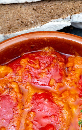 Peppers (del Piquillo) stuffed with meat or fish. Roasted red peppers and fillings made at home. Recipe of Spanish food and Mediterranean diet. With delicious sauce to spread bread. Stock fotó